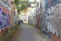 Street art corridor in Uzupio, an artistic district in Vilnius, Lithuania Stock Photography