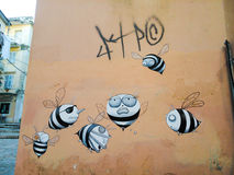 Street art. Black and white bees in a wall in Corfu island Greece Stock Photo