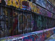 Street Art Bombed Caged Wall stock photos