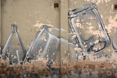Street art. Cans and bottles on the wall stock images