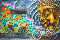 Street art in Copenhagen and classic vintage retro city bicycle Royalty Free Stock Photos