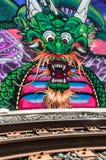 Street Art Dragon. Street Art of Sacramento displaying dragon behind rail line Royalty Free Stock Photo