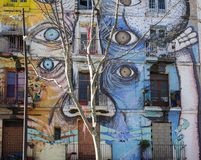 Street art in El Raval district, on March 10, 2013 in Barcelona, Spain. BARCELONA - MARCH 10: Street art in El Raval district, on March 10, 2013 in Barcelona Stock Photos