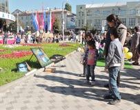 Street art exhibition and sale onlookers Stock Image