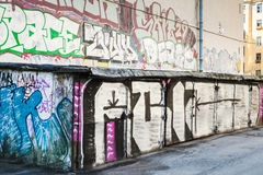 Street art, garages with grungy graffiti patterns Stock Photo