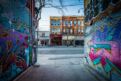 Street art in Graffiti Alley and buildings on Queen Street West,. In the Fashion District of Toronto, Ontario Stock Image