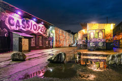 Street art graffiti in Berlin streets by night. BERLIN, GERMANY - OCTOBER 21, 2015: street art graffiti on the wall of Cassiopeia club in the urban area of royalty free stock photos