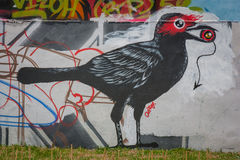 Street art graffiti. Bird paintings on the wall. Stock Images