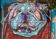 Street art graffiti. Dog paintings on the wall. Stock Photography
