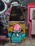 Street art graffiti. Figure on a box, colorful urban art stock illustration