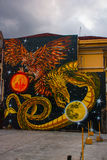 Street art graffiti. The picture of the dragon and the eagle with the planets. Manila Philippines Royalty Free Stock Photos