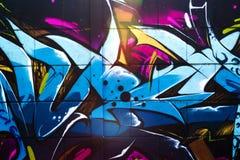 Street art graffiti. Vibrant multicolor detail of graffiti art on the wall royalty free stock image