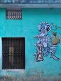 Street art on a green wall. stock photo