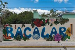 Street art on a house wall in the center of bacalar, quintana roo, mexico.  stock photo
