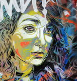 Street art - Ladies face. Girls face painted on wall with many colors stock photos
