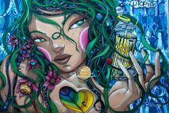 Street art in Lisbon. Lisbon, Portugal - August 24, 2017 Large scale legal graffiti by Utopia on Amoreiras Wall, Lisbon Stock Photos