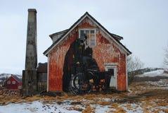 Street art in Lofoten. A Batman graffiti piece on an abandoned fishing lodge in Lofoten, Norway Stock Image