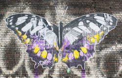 Street art in London:artwork representing a big butterfly on a brick wall. Shoreditch, London, UK, September 28 2014: Street art in London: artwork representing stock photography
