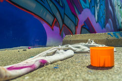 Street Art Materials. Street Art of Sacramento displaying left over materials in front of finished mural Stock Images