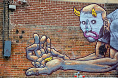 Street art Montreal stingy man stock image