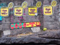 Street art next to Batu Bolong showing useless cans, trash and coconut stock photos