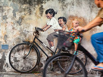 Street art object children on bicycle in Georgetown Penang stock image
