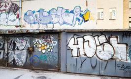 Street art, old locked garages with grungy graffiti Stock Photos