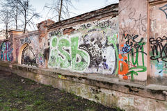 Street art, old urban walls with grungy graffiti Stock Photo