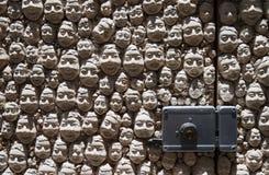 Street art - open door art - faces Stock Photography