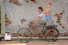 STREET ART Painting on the the wall happy girl riding on bike in Royalty Free Stock Image