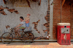 STREET ART Painting on the the wall happy girl riding on bike in Royalty Free Stock Photography
