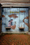 STREET ART Painting on the the wall two cute little sisters havi Royalty Free Stock Images
