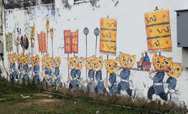 Street Art at Penang, Cats & Humans Happily Living Together. 'Cats & Humans Happily Living Together' is a mural created by ASA, Artists for Stray Animals, in stock image