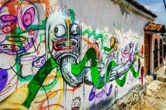 Street art in San Cristobal de las Casas, Mexico. San Cristobal de las Casas, Mexico - March 26, 2015: Street art on old house wall stock photography
