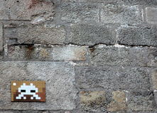 Street art - Space invader. Space invader art on wall in the street stock photography