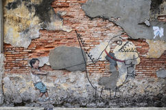 Street art titled Little Boy with Pet Dinosaur by Ernest Zachare Stock Image