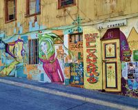 Street Art in Valparaiso, Chile. Typical street art mural on a street in Valparaiso, Chile. Painting covers walls, doors and windows. The design range from stock photos