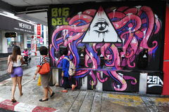 Street Art. View of street art by Big Del on a wall in the city centre on March 15, 2013 in Bangkok, Thailand. The Thai capital is renowned for its vibrant Stock Images