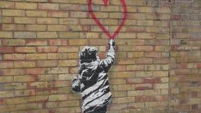 Street art. Wall graffiti - a boy and a heart. stock footage