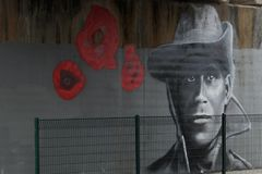 Street Art Wall Mural. Unfinished wall mural, being prepared for Remembrance Day in November. Ringwood Victoria Australia Stock Photography