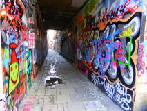 Street art on walls of alley stock images
