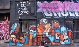 Street art weird faces Stock Image