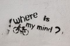 Street Art - Where is my mind?. This is a spray painted wall with the question. Where is my mind? It also has a bike or bicycle royalty free stock image