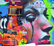 Street art woman. MONTREAL,CANADA AUGUST 08 2015: Street art woman. Montreal is the perfect place to walk in the back alleys and abandoned areas, looking for Stock Photo