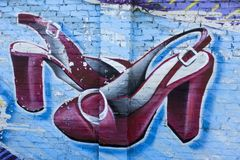 Street art a women`s sandals. Beautiful painted on the wall women`s sandals Royalty Free Stock Image