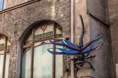Street art in Wroclaw. Street art in european street dragonfly sculpture on an old building Stock Image