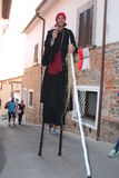 Street artist - The acrobat on stilts Stock Image