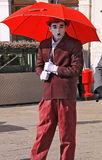 Street artist as Charlot. Street artist performing a famous Charlie Chaplin character on the street of Venice Royalty Free Stock Images