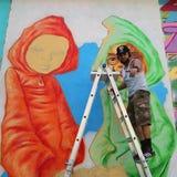 Street artist Bob Plater painting mural at JMZ Walls in Brooklyn Royalty Free Stock Photos