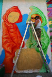 Street artist Bob Plater painting mural at JMZ Walls in Brooklyn Royalty Free Stock Photography